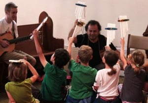 Gerardo Calderon with young musicians at Grace Art Camp.