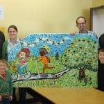 Representatives from Kinder Morgan join Young Audiences Development Director Christi Crowley, Teaching Artist Mark Brody, and students Gus and Dawson to unveil Beverly Cleary School's new mosaic.